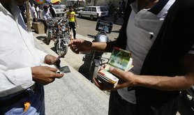 Fatah members withdrawing foreign aid currency in Rafah