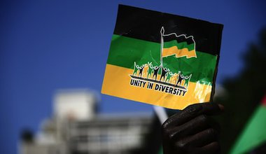 An ANC supporter holds the party's flag during a march in Cap Town. Demotix/Miriam Mannak. All rights reserved.
