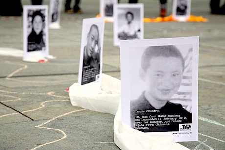 Pictures of self-immolated Tibetan monks put by protesters in front of the German Chancellery in Berlin. Demotix/Thorsten Strasas. All rights reserved.
