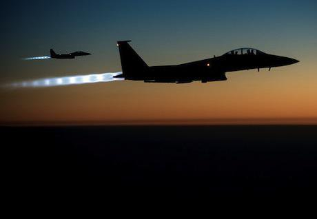 USAF F-15E fighters. Flickr/Stuart Rankin. Some rights reserved.