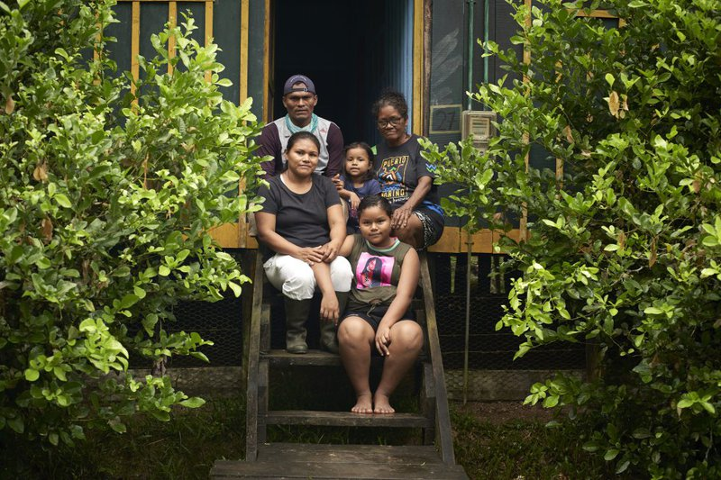 Lilia Isolina Java Tapayuri poses for a portrait with her husband Aldo, her children Ainara and Michel and her mother Tapayuri, in front of her home in the Colombian community of San Francisco, a few miles northwest of Puerto Nariño, on the Loretoyacu River.