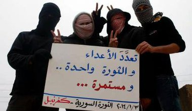 'Enemies are many.The revolution is one. It will continue.' Kafranbel, Syria 3/1/14. Courtesy of Placards of Occupied Kafrenbel