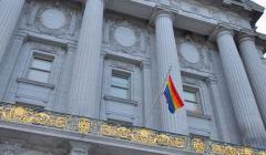 A rainbow flag flies from San Francisco City Hall the day Prop 8 was argued at the US Supreme Court