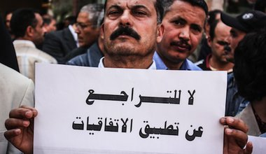 """""""No renunciation to apply the conventions"""". Professors observe general strike in Tunisia in April 2013. Demotix/Chedly Ben Ibrahim. All rights reserved."""