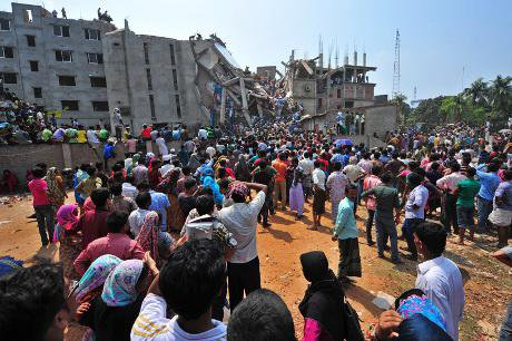Army personnel and civilian volunteers work on the scene after an eight-storey building collapsed in outskirts of Dhakar