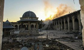 Historic minaret of the Great Umayyad Mosque destroyed in Aleppo. Demotix/Halabi Lens. All rights reserved.