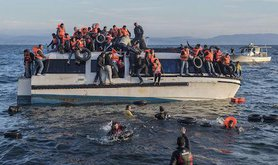 Refugees on boat. Ggia/Wikimedia Commons. Some rights reserved.