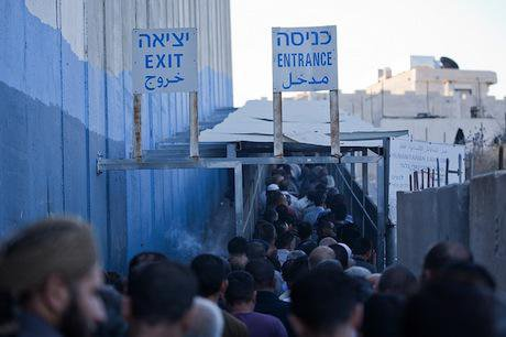 Palestinian workers continue their daily wait to cross into Israel. Demotix/Hussain Abdel Jawwad. All rights reserved.