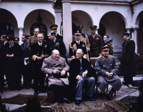 Churchill, Roosevelt, and Stalin seated before photographers at the Yalta Conference, 1945