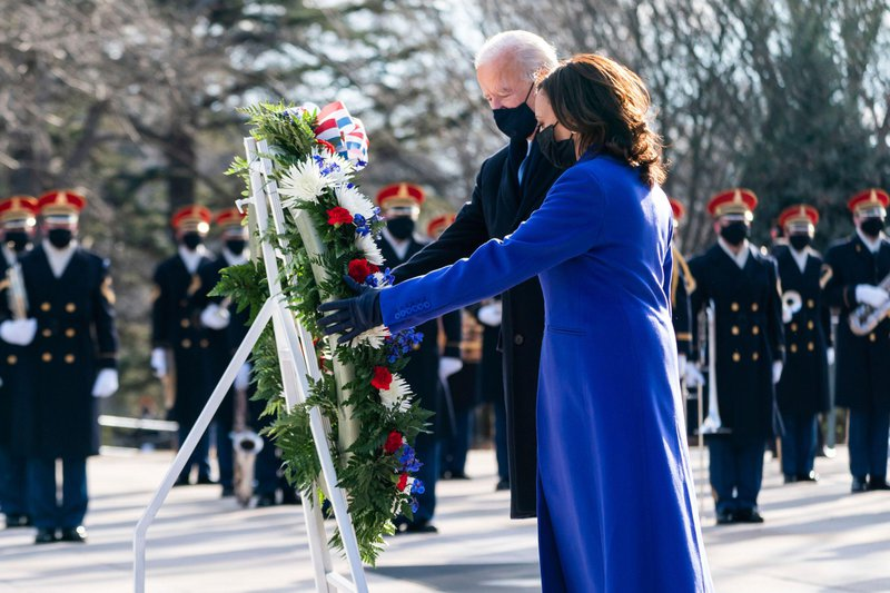 Joe Biden and Vice President Kamala Harris place a wreath at the Tomb of the Unknown Soldier on Inauguration Day