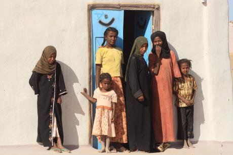 Girls in front of their home in north Sudan.