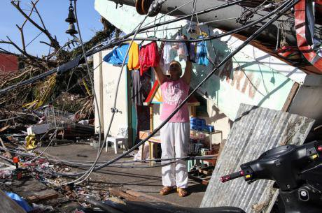 Man hangs washing in Tacloban City, Philippines. Demotix/Herman Lumanog. All rights reserved.