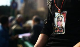 A young man wears a General Sisi picture in Tahrir Square
