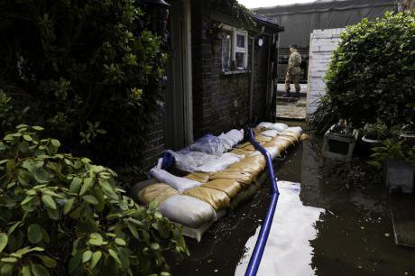 The army securing a house in Surrey following the flooding