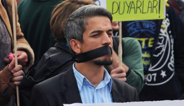 A demonstrator in Turkey protests against government censorship.