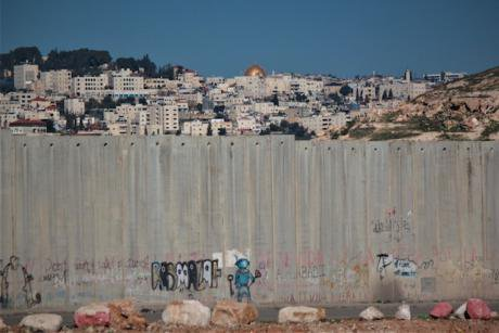 4. The Dome of the Rock in seen behind the separation wall in Jerusalem. Photo Daniel Avelar copy.jpg