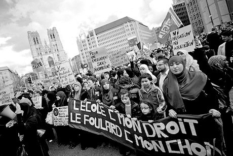 A protest against the ban in Brussels. Flickr/Mkhalili. Some rights reserved.