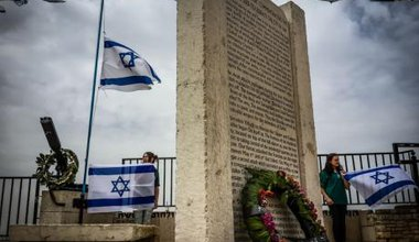 66th Memorial Day in Safed: Israeli youth in northern Galilee hold flags at attention near a memorial to casualties in the Israe