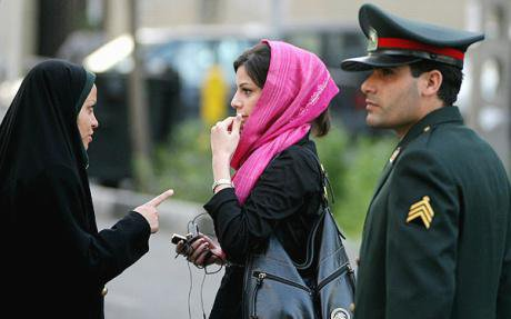 Iranian woman reprimanded for dress