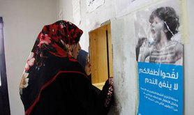 Two Syrian women wait to collect a prescription at a health clinic in Lebanon's Bekaa Valley, 2013.