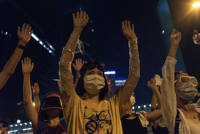 Occupy protesters prepare for tear gas, Hong Kong. Demotix/Robert Godden. All rights reserved.