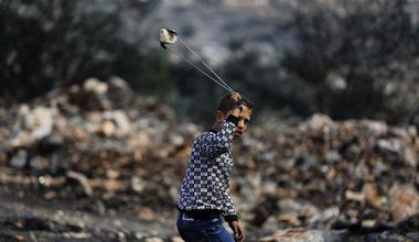 Palestinian boy with a slingshot. Ahmed Talat/Demotix. All rights reserved.