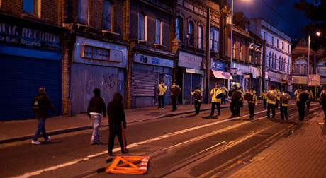 Stand-off between rioters and police in Croydon, London 2011.
