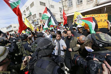 Isaeli army and border police troops stop Palestinians entering Al-Shuhada ( Martyrs') St., Hebron, during the demo on the twent