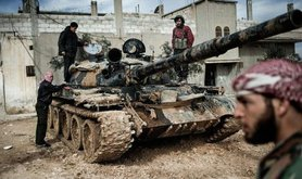 Free Syrian Army members with a tank whose crew defected from government forces. Freedom House/Flickr. Some rights reserved.