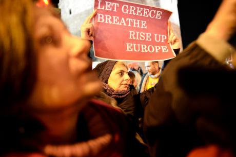 Greeks rally in support of their new government's negotiating stance.