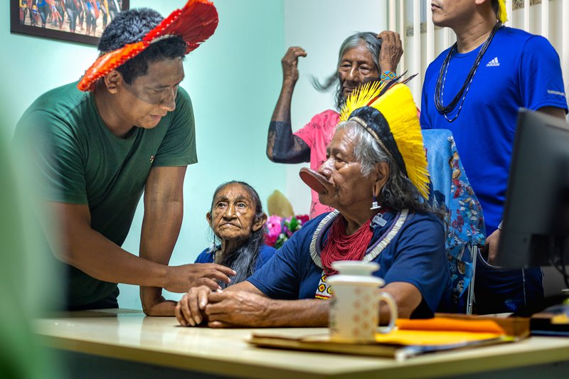 Indigenous people talk at the table