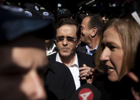 Tzipi Livni and Isaac Herzog on election campaign, 2014.