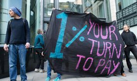 Activists in anti-austerity protest outside Goldman Sachs International.