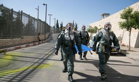 Security forces simulate chemical attack outside Israeli Parliament.