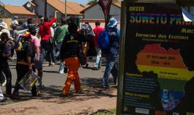 """""""Giving homophobia a red card,"""" reads a poster for the 2012 Soweto Pride march."""