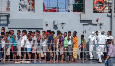 Rescued refugees shipwrecked off Libya arrive in Palermo.