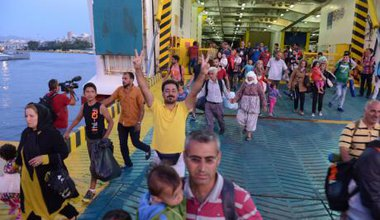 Refugees dropped daily at Piraeus Harbour,Greece.