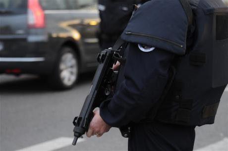 Aftermath of Paris Attacks: police officers control vehicles in Lyon.