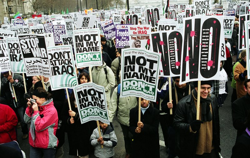 People attend a protest against the Iraq War in London