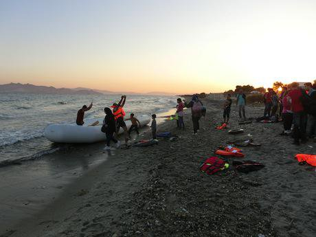 A boat carrying refugees arrives in Kos, Greece. Christopher Jahn:IFRC:Flickr. Some rights reserved.jpg