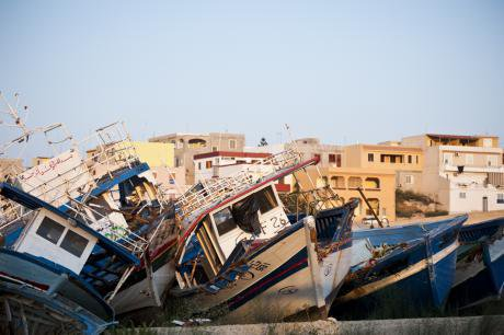 A 'migrant boat cemetery' in Lampedusa, Italy. Michele Lapini/Demotix. All rights reserved.