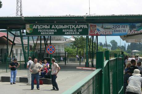 Border crossing in Abkhazia. The sign on the right reads 'Abkhazia and Russia, 200 years together.'