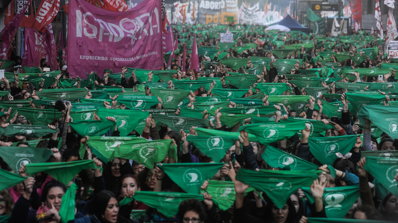 Abortion rights activists raise green scarves in Buenos Aires, Argentina, 2019