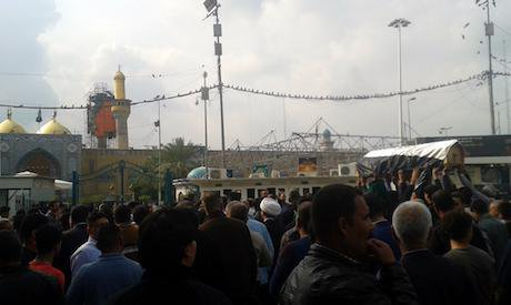 A martyr of the war against Daesh is carried to the Kathimiyya shrine in Baghdad. Ali Ali. All rights reserved.