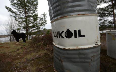 A barrel labelled 'Lukoil' sits in the middle of a field in Khanty-Mansiysk.