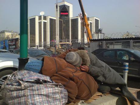 Two beggars sleep in front of Lukoil's headquarters, 2010.