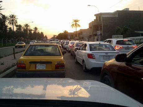 Cars old and new in Baghdad's frequent traffic jams. Ali Ali. All rights reserved.