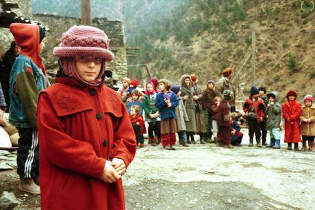 Chechen refugee children in Georgia in 1999. Their clothes are ragged.
