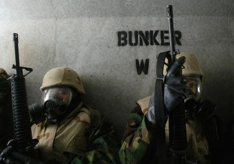 US troops in chemical weapons suits, Kuwait, Iraq. PA / PA Archive/Press Association Images. All rights reserved.