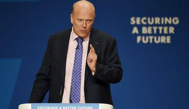 Former justice secretary Chris Grayling giving speech in front of poster which says, securing a better future